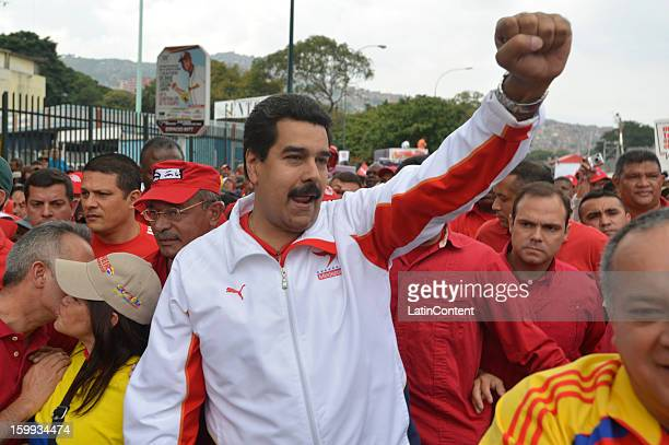 Venezuelan Vice President Nicolas Maduro attends a rally in celebration of the 56th anniversary of the overthrow of the last dictatorship in the...