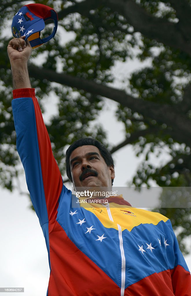Venezuelan Vice President Nicolas Maduro greets supporters during the commemoration of the 1992 failed coup led by Chavez, who was an army lieutenant colonel, against then president Carlos Andres Perez, in Caracas, on February 4, 2013. Ailing President Hugo Chavez, who had cancer surgery in December, is doing much better and recovering, Cuban leader Fidel Castro said in remarks published Monday. AFP PHOTO