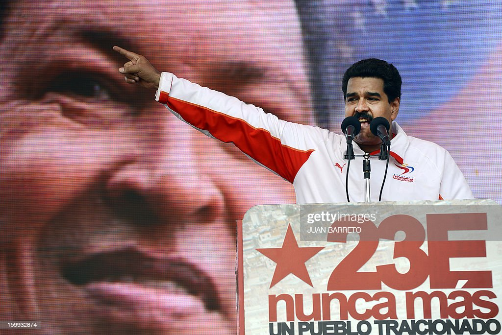 Venezuelan Vice President Nicolas Maduro speaks during a meeting to commemorate the 55th anniversary of the end of the dictatorship (1952-1958) of Marcos Perez Jimenez in Caracas on January 23, 2013. Thousands of Venezuelans marched in support of cancer-stricken President Hugo Chavez in Caracas Wednesday on the anniversary of the day the country's last dictator was overthrown. AFP PHOTO/JUAN BARRETO