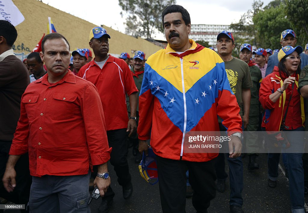 Venezuelan Vice President Nicolas Maduro walks during the conmemoration of the 1992 failed coup led by Chavez, who was an army lieutenant colonel, against then president Carlos Andres Perez, in Caracas, on February 4, 2013. Ailing President Hugo Chavez, who had cancer surgery in December, is doing much better and recovering, Cuban leader Fidel Castro said in remarks published Monday. AFP PHOTO