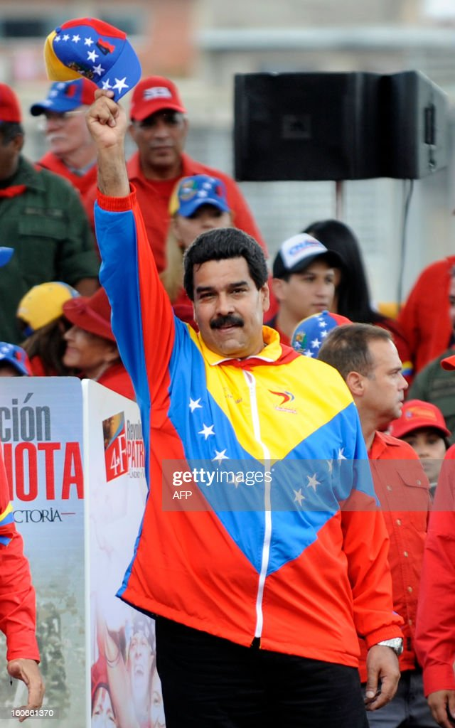 Venezuelan Vice President Nicolas Maduro waves during the conmemoration of the 1992 failed coup led by Hugo Chavez, who was an army lieutenant colonel, against then president Carlos Andres Perez, in Caracas, on February 4, 2013. Ailing President Hugo Chavez, who had cancer surgery in December, is doing much better and recovering, Cuban leader Fidel Castro said in remarks published Monday. AFP PHOTO/Leo RAMIREZ AFP PHOTO/ Leo RAMIREZ