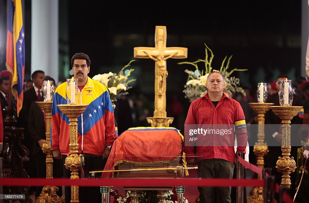 Venezuelan Vice-President Nicolas Maduro (L) and Diosdado Cabello, Venezuelan president of the National Assembly stand next to the coffin of late Venezuelan President Hugo Chavez at the Military Academy on March 6, 2013 in Caracas. Venezuela was plunged into uncertainty Wednesday after the death on the eve of President Hugo Chavez, who dominated the oil-rich country for 14 years and came to embody a resurgent Latin American left. AFP PHOTO/Presidencia