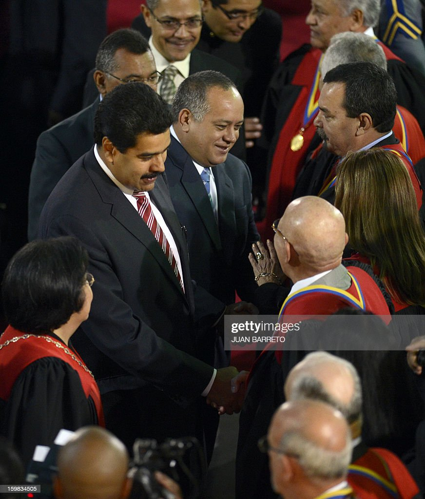 Venezuelan Vice-President Nicolas Maduro (L) and the president of the Venezuelan National Assembly Diosdado Cabello (C) shake hands with judges during a ceremony for the beginning of the judicial year, in Caracas on January 21, 2013. AFP PHOTO