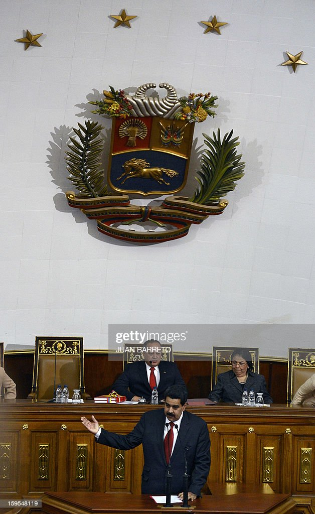 Venezuelan Vice-President Nicolas Maduro delivers a speech after handing the ledger of the country to the president of the National Assembly Diosdado Cabello (C, top) in Caracas on January 15, 2013. AFP PHOTO