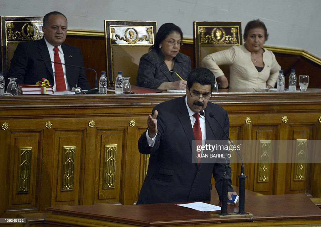 Venezuelan Vice-President Nicolas Maduro (C) delivers a speech after handing the ledger of the country to the president of the National Assembly Diosdado Cabello (L, top) in Caracas on January 15, 2013. AFP PHOTO/JUAN BARRETO