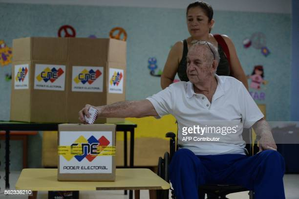 A Venezuelan votes during regional elections in Caracas' municipality of Chacao where people choose the governor for the state of Miranda on October...