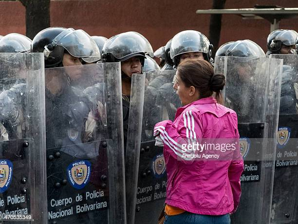 Venezuelan woman argues with members of the National Bolivarian Guard during an antigovernment demonstration in the Altamira neighborhood of Caracas...