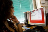 A Venezuelan woman watches the personal internet webpage of President Hugo Chavez in Twitter April 29 2010 in Caracas The user name chosen by Chavez...