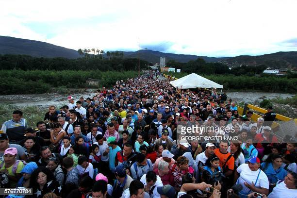 Venezuelans cross the Simon Bolivar bridge linking San Antonio del Tachira in Venezuela with Cucuta in Colombia to buy basic supplies on July 17 2016...