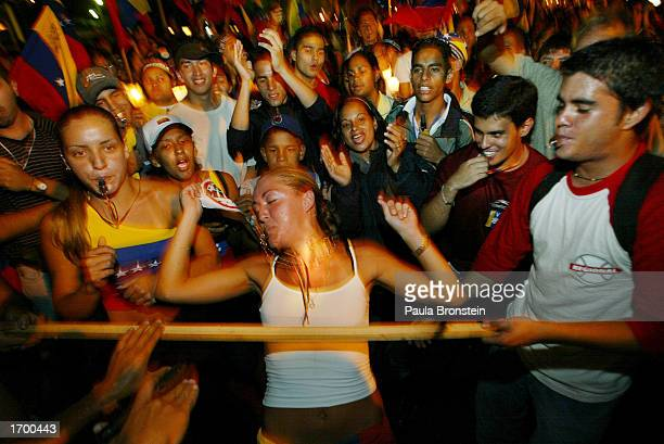 DECEMBER 23 Venezuelans do the limbo dance during a march and rally drawing nearly half a million opposition flagwaving protesters December 23 2002...