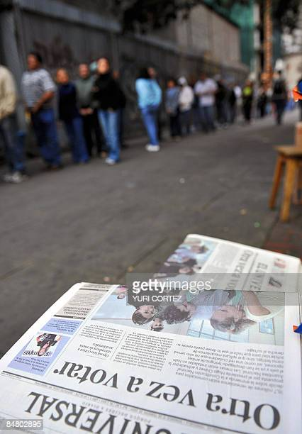 Venezuelans line up to vote in a poll center in Caracas on February 15 2009 during a referendum for 'Yes' or 'No' to a constitutional amendment...