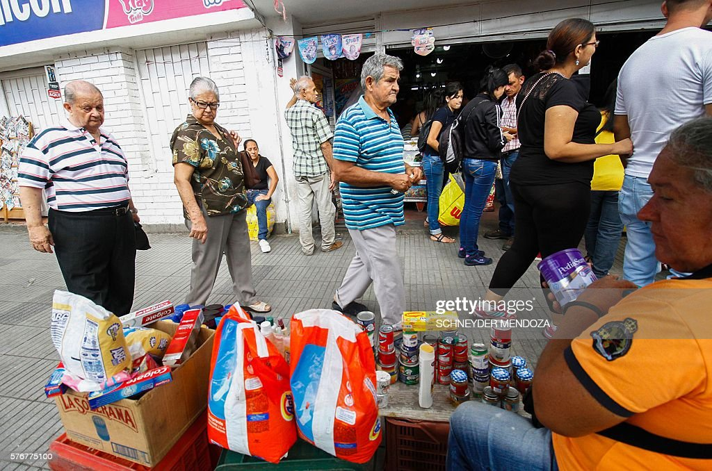 Venezuelans shop for groceries along the streets of Cucuta Colombia on July 17 2016 Thousands of Venezuelans crossed the border with Colombia to take...