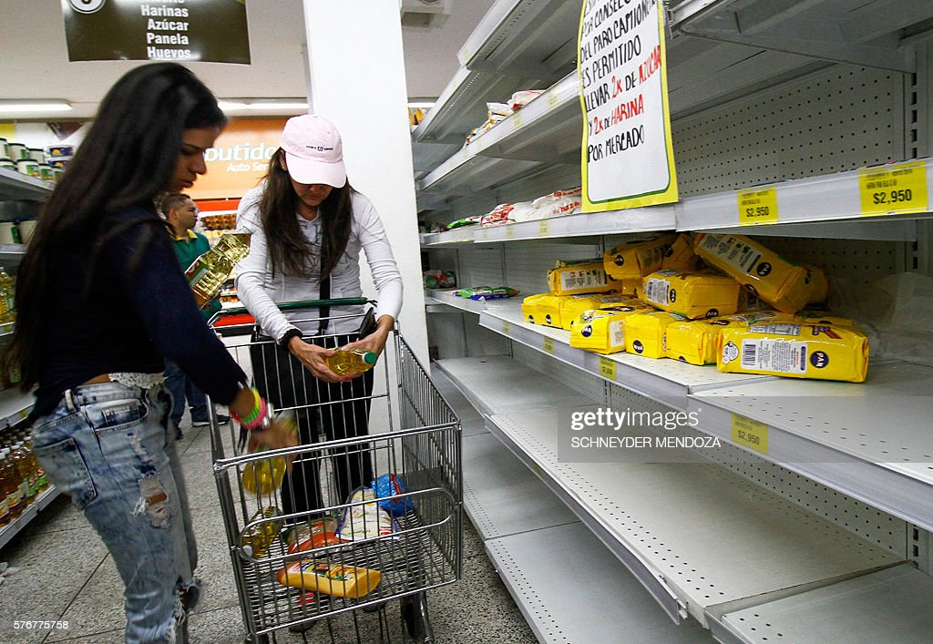 Venezuelans shop for groceries at a supermarket in Cucuta Colombia on July 17 2016 Thousands of Venezuelans crossed the border with Colombia to take...