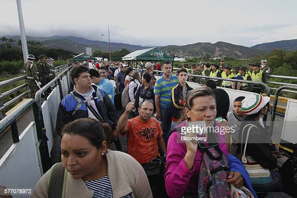 Venezuelans show identification while crossing the Simon Bolivar bridge into Cucuta Colombia on Sunday July 17 2016 For only the third time in a year...