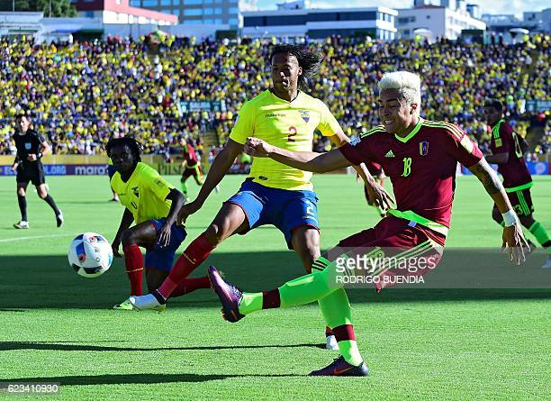 Venezuela's Adalberto Penaranda strikes the ball as Ecuador's Arturo Mina looks on during their 2018 FIFA World Cup qualifier football match in Quito...