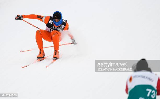 TOPSHOT Venezuela's Adrian Solano crashes as he competes during the Men 16 km Sprint Free qualification at the FIS Nordic Ski World Championship in...