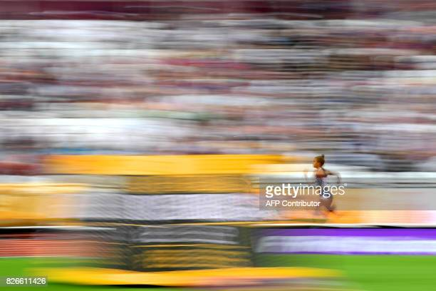 TOPSHOT Venezuela's Andrea Purica competes in the heats of the women's 100m athletics event at the 2017 IAAF World Championships at the London...