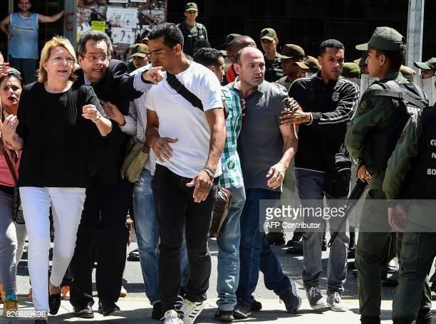 Venezuela's chief prosecutor Luisa Ortega one of President Nicolas Maduro's most vocal critics is seen during a flash visit to the Public...