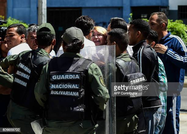 TOPSHOT Venezuela's chief prosecutor Luisa Ortega one of President Nicolas Maduro's most vocal critics is surrounded by people and national guards...