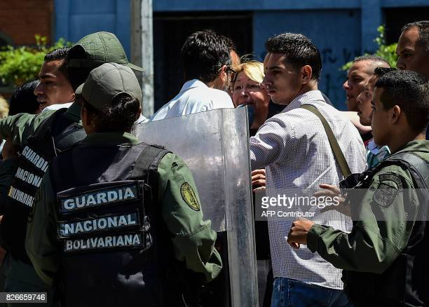 Venezuela's chief prosecutor Luisa Ortega one of President Nicolas Maduro's most vocal critics is surrounded by people and national guards during a...