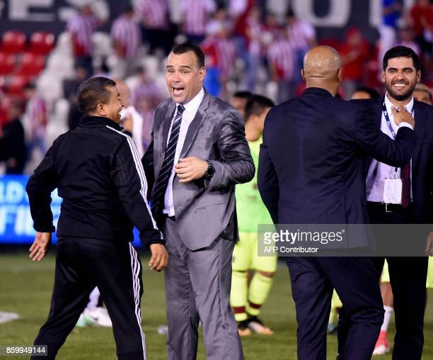 Venezuela's coach Rafael Dudamel celebrates with team staffers after defeating Paraguay during their 2018 World Cup football qualifier match in...