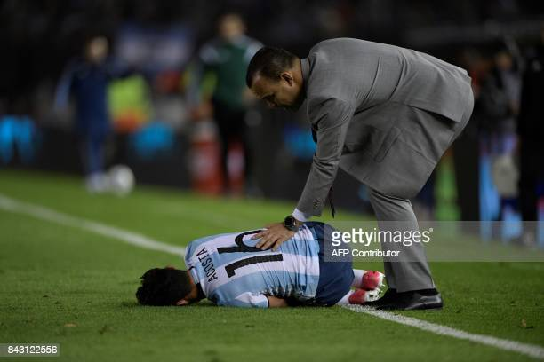 Venezuela's coach Rafael Dudamel comforts Argentina's Lautaro Acosta during their 2018 World Cup qualifier football match in Buenos Aires on...