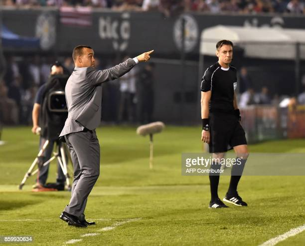 Venezuela's coach Rafael Dudamel gives instructions to his players during their 2018 World Cup football qualifier match against Paraguay in Asuncion...