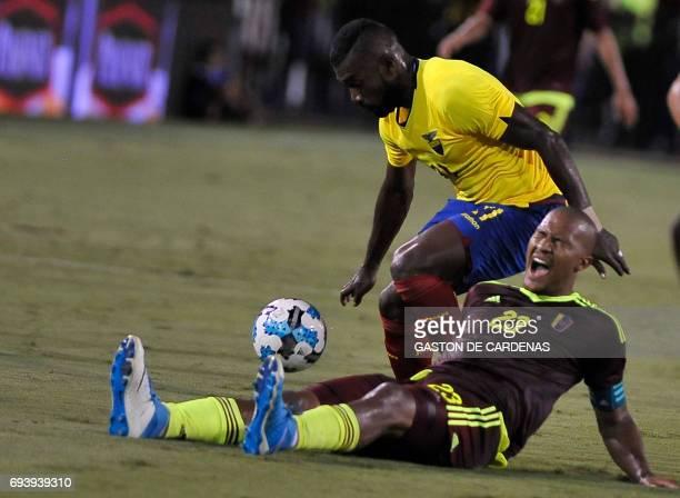 Venezuela's defender Salomon Rondon vies for the ball with Ecuador's Gabriel Achiller during their friendly soccer match at FAU stadium in Boca Raton...