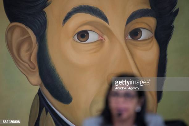 Venezuela's Foreign Minister Delcy Rodriguez speaks in front of Liberator Simon Bolivar's portrait during a press conference in Caracas Venezuela on...