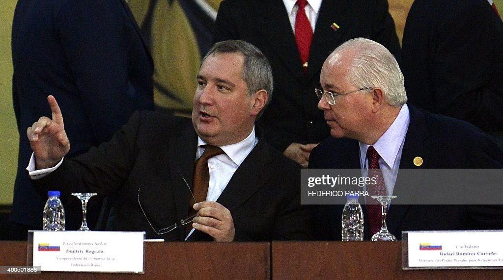Venezuela's Foreign Minister Rafael Ramirez (R) listens to Russian Vice-Prime Minister <a gi-track='captionPersonalityLinkClicked' href=/galleries/search?phrase=Dmitry+Rogozin&family=editorial&specificpeople=2151537 ng-click='$event.stopPropagation()'>Dmitry Rogozin</a> (L) during a meeting in Caracas on December 15, 2014.