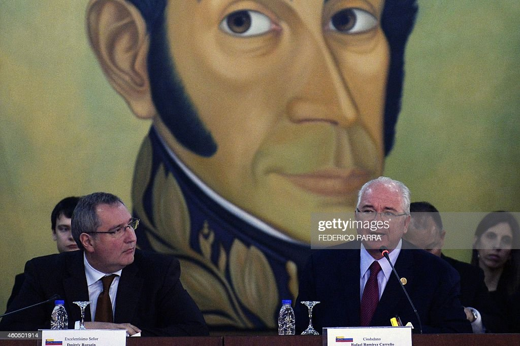 Venezuela's Foreign Minister Rafael Ramirez (R) speaks next to Russian Vice-Prime Minister <a gi-track='captionPersonalityLinkClicked' href=/galleries/search?phrase=Dmitry+Rogozin&family=editorial&specificpeople=2151537 ng-click='$event.stopPropagation()'>Dmitry Rogozin</a> (L) during a meeting in Caracas on December 15, 2014.