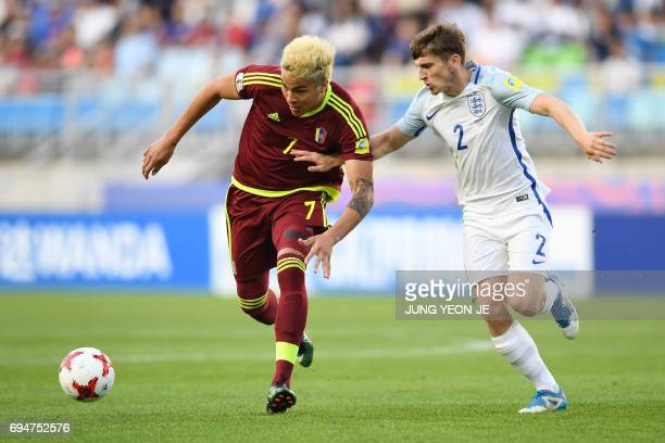 Venezuela's forward Adalberto Penaranda Maestre and England's defender Jonjoe Kenny compete for the ball during the U20 World Cup final football...