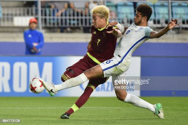 Venezuela's forward Adalberto Penaranda Maestre and England's defender Jake ClarkeSalter compete for the ball during the U20 World Cup final football...