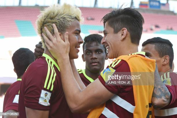 Venezuela's forward Adalberto Penaranda Maestre is congratulated by a teammate after scoring during their U20 World Cup quarterfinal football match...