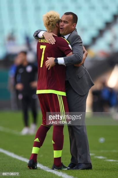 Venezuela's forward Adalberto Penaranda Maestre is congratulated by coach Rafael Dudamel after he scored during their U20 World Cup quarterfinal...
