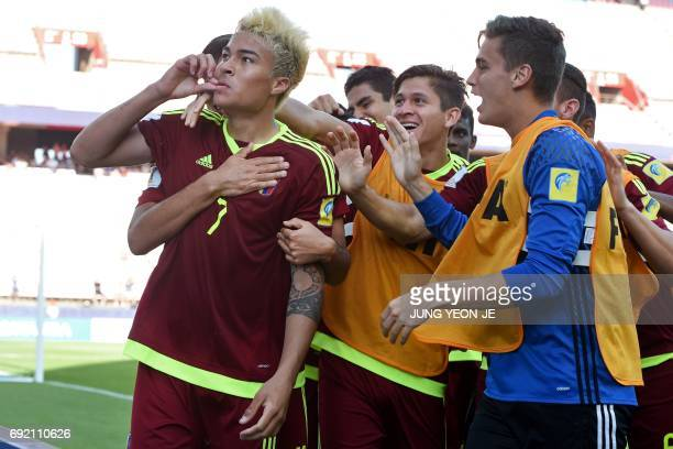 Venezuela's forward Adalberto Penaranda Maestre is congratulated by his teammates after scoring during their U20 World Cup quarterfinal football...