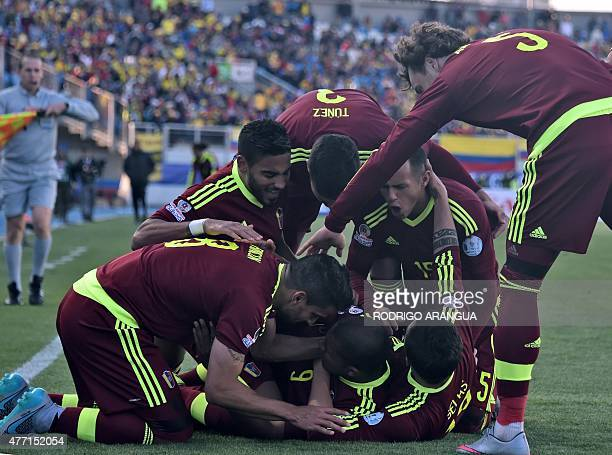 Venezuela's forward Jose Rondon celebrates with teammates after scoring against Colombia during their 2015 Copa America football championship match...