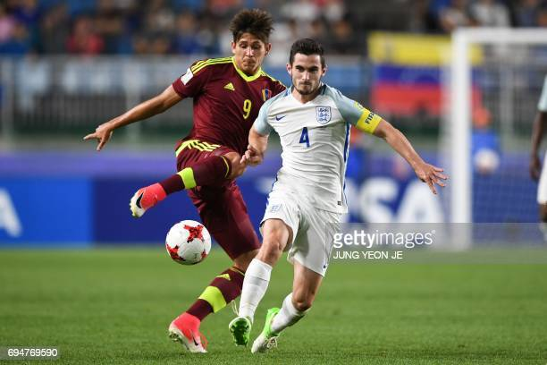 Venezuela's forward Ronaldo Pena and England's midfielder Lewis Cook compete for the ball during the U20 World Cup final football match between...