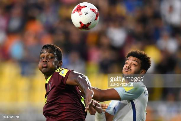 TOPSHOT Venezuela's forward Sergio Cordova and England's defender Jake ClarkeSalter compete for the ball during the U20 World Cup final football...
