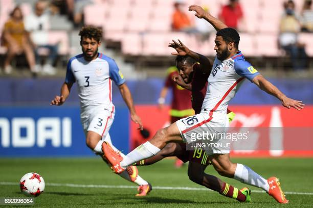 Venezuela's forward Sergio Cordova fights for the ball with US defenders Danny Acosta and Cameron CarterVickers during their U20 World Cup...