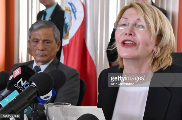 Venezuela's fugitive former top prosecutor Luisa Ortega flanked by Costa Rica's General Prosecutor Jorge Chavarria speaks during a press conference...