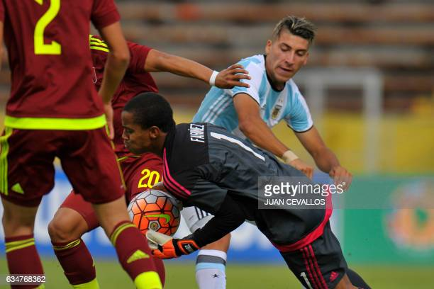 Venezuela's goalkeeper Wuilker Farinez Aray grabs the ball next to Argentina's player Marcelo Torres during their South American Championship U20...