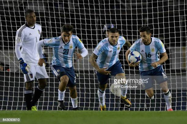 Venezuela's goalkeeper Wuilker Farinez gestures as Argentina's Paulo Dybala Mauro Icardi and Lautaro Acosta run with the ball after Venezuela's Rolf...