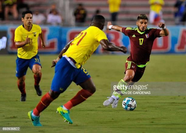 Venezuela's Jacobo Kouffati vies for the ball against Gabriel Achiller of Ecuador during their friendly soccer match at FAU stadium in Boca Raton...