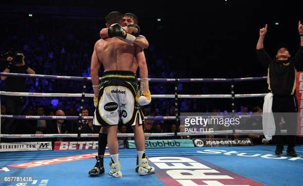 Venezuela's Jorge Linares embraces England's Anthony Crolla following his unanimous decision victory in their WBA WBC Diamond Ring Magazine...