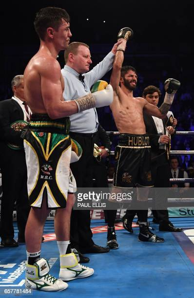 Venezuela's Jorge Linares is declared winner by unianimous decision over England's Anthony Crolla following their WBA WBC Diamond Ring Magazine...