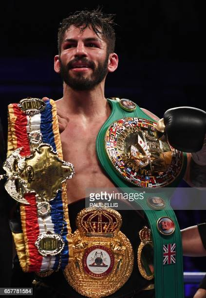 Venezuela's Jorge Linares wears his medals following his unianimous decision victory over England's Anthony Crolla in their WBA WBC Diamond Ring...