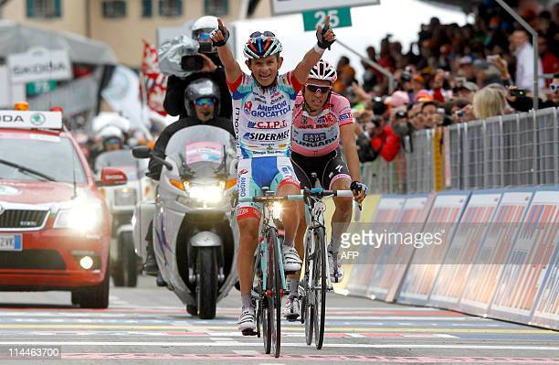 Venezuela's Jose Rujano of the Androni team crosses the finish line ahead of Spain's Alberto Contador of Saxo Bank to win the 13rd stage of the 94th...