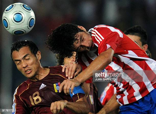 Venezuela's Juan Arango jumps for a header with Paraguay's Cristian Riveros during their FIFA World Cup South Africa2010 qualifier football match at...