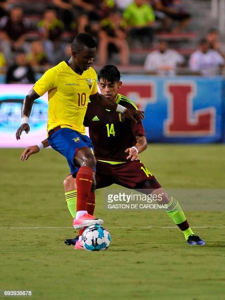 Venezuela's Junior Moreno vies for the ball against Juan Casares of Ecuador during their friendly soccer match at FAU stadium in Boca Raton Florida...